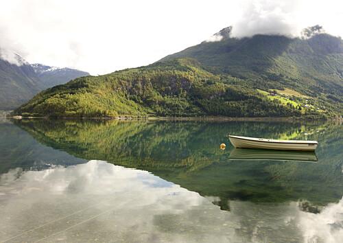 Little boat on the water, fjord landscape, Sogn og Fjordane, Norway, Scandinavia, Europe