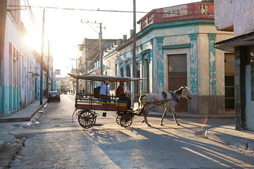horse-drawn carriage in a colonial town, Santa Clara, family travel to Cuba, parental leave, holiday, time-out, adventure, Santa Clara, province Villa Clara, Cuba, Caribbean island