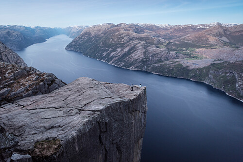 one person sitting with tailor seat at Preikestolen or Prekestolen, Lysefjord, Rogaland Province, Norway, Scandinavia, Europe