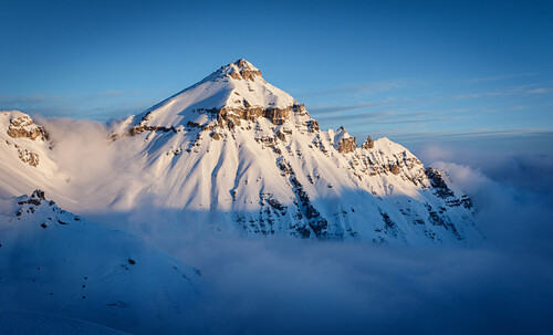 Mount Serles reaches out the sea of clouds on a winter morning, Stubai Alps, Tyrol, Austria