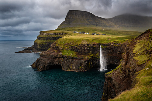 Múlafossur waterfall drops into the Atlantic ocean close by the village of Gásadalur, Vagar, Faroe islands