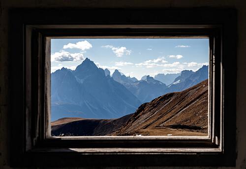 View through an old window of a bunker, Stoneman Trail, Lienzer Dolomites, East Tyrol, Austria