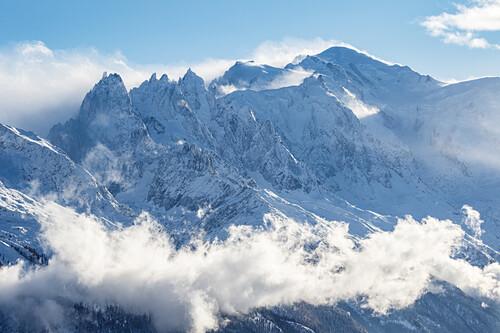 Summit of Mont Blanc mountain range during winter, clouds and fog, Aguille du Midi, Chamonix, Haute-Savoie, France