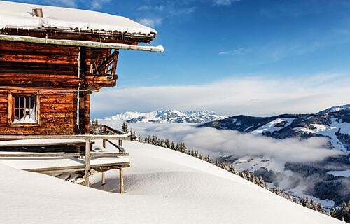 Snow covered hut above the valley of Langer Grund, Kelchsau, Kitzbühel Alps, Tyrol, Austria