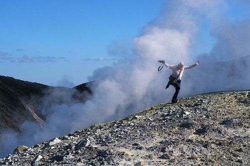 Man comes out of the volcanic steam at the crater rim on the volcano, Vulkano Island, Aeolian Islands, southern Italy