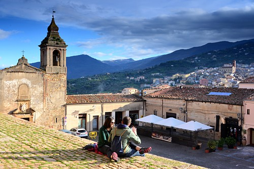 two people at the castle, Castelbuono in the highlands of the Medonie near Cefalu, north coast, Sicily, Italy