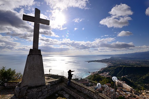 Cross and view and sea and coast, Santuario Madonna della Rocca, Taormina, east coast, Sicily, Italy