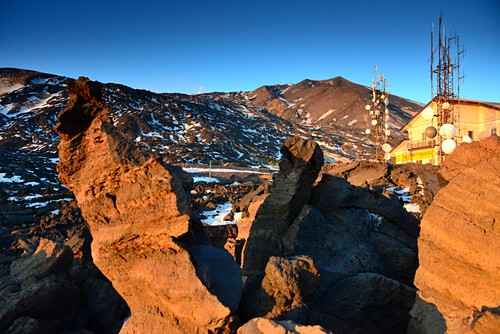 Lava rocks and antennas and hut under the Etna volcano, south side, east coast, Sicily, Italy