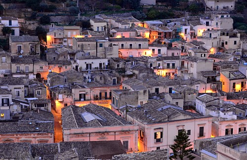 Evening view of the lower town, lights, Modica, southern Sicily, Italy