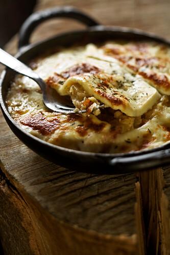France, Savoie, Val d'Isere, La Ferme de l'Adroit farm, the Pela (Tartiflette cooking in a pan), recipe of L'Etable d'Alain Restaurant
