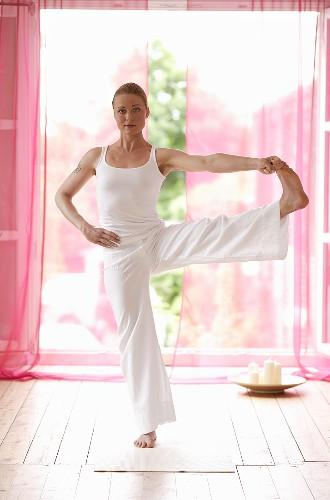 Yoga posture: Utthita Hasta Padangusthasana (Hand to Toe Pose)