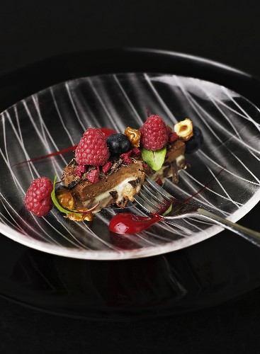 A piece of chocolate-mint tart with raspberries