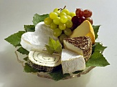 Still Life: Assorted Cheeses with Grapes on a Glass Plate