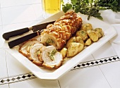 Herb-filled Rolled Roast with fried Potatoes