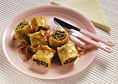 Rolled pasta parcels with mince and spinach filling