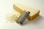 A piece of Parmesan with grater (Emilia-Romagna, Italy)