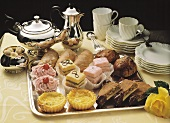 Various tea cakes & petit fours on silver tray