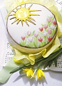 Decorated spring cake with iced tulips and sun