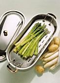 Green asparagus in an asparagus pan