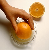 Preparing Fresh-Squeezed Orange Juice