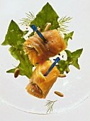 Salmon rolls on dandelion leaf salad
