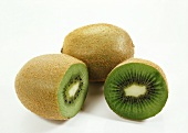 Whole and sliced kiwi fruit