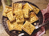 Pieces of tray-baked onion tart