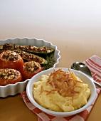 Mashed Potatoes with Stuffed Tomatoes and Zucchini
