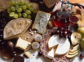 Assorted Cheese with Grapes and Wine