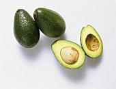 Avocados; one cut open