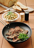 Marinated beef with beans
