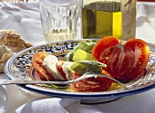 Tomatoes with mozzarella & basil; decoration: olive oil