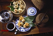 Dim Sum with Chopsticks and Leaves; Bamboo Steamer