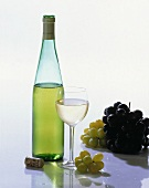 A Bottle of White Wine with Glass