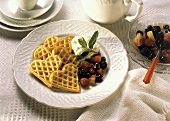 Heart-shaped Waffles with Berries; Whipped Cream