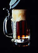 A Stein of Foaming Dark Beer