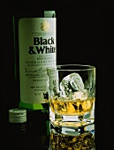 A Bottle and a Glass of Scotch; Black & White Scotch