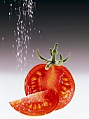 Pouring Salt on a Tomato Wedge