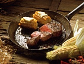 Juicy Steak with Corn-on-the-Cob in a Pan