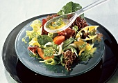 Mixed Greens Salad with Dressing in Plastic Spoon