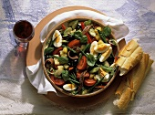 Colorful Salade Nicoise with French Bread; Wine