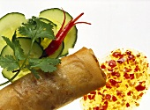 Close Up of Spring Roll with Sauce; Cucumber Slices
