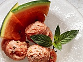 Melon ice cream on glass plate