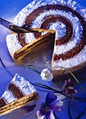 Coffee almond gateau on glass platter