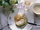 Two slices of saddle of veal with herb crust and vegetables au gratin