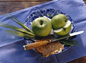 Two Granny Smiths; cereals; bread; plate