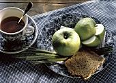 Two Apples; A Slice of Whole Grain Bread; Tea