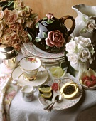Tea party; rose-patterned teapot and plate
