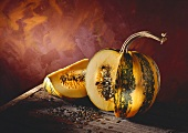 Pumpkin or Squash; Quartered on a Wooden Table