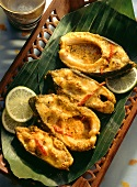 Fish in yoghurt sauce on banana leaves